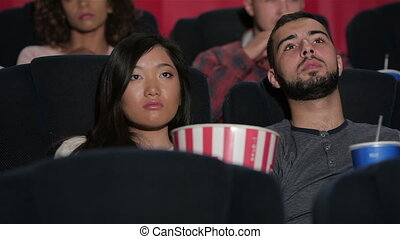 Happy couple at the cinema