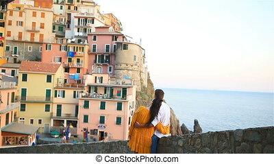 Happy couple background stunning village of Manarola, Cinque Terre, Liguria, Italy
