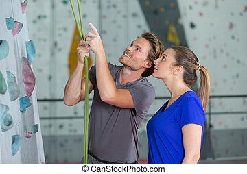happy couple before climbing up the wall together