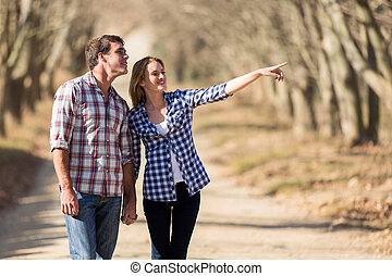 couple bird watching outdoors in fall