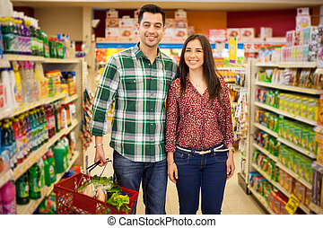 Happy couple buying some groceries