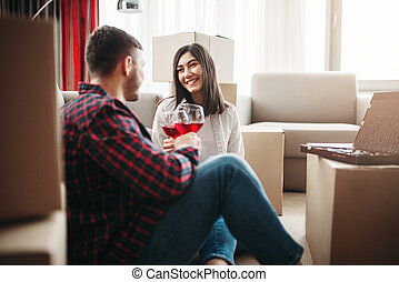 Happy couple celebrate moving to new house