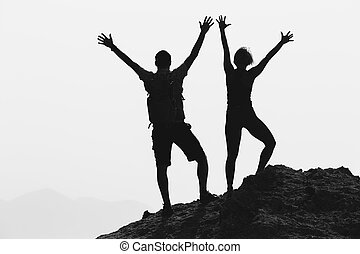 Happy couple celebrate reaching life goal and success