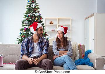 Happy couple celebrating christmas holiday