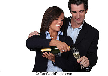 happy couple celebrating event with champagne