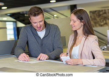 happy couple checking accountancy