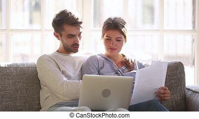 Happy couple checking easy service to pay domestic bills...