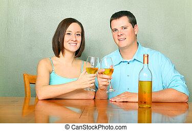 Happy Couple Cheering With Wine