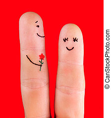 happy couple concept - a man with flower and a woman, painted at fingers isolated on red background