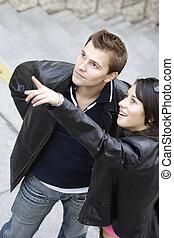 Happy couple considering something interesting