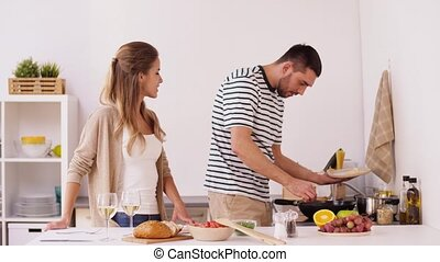 happy couple cooking and serving food at home - food, people...