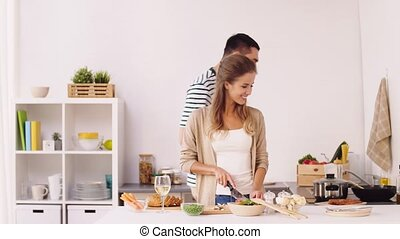 happy couple cooking food at home kitchen - cooking, people...