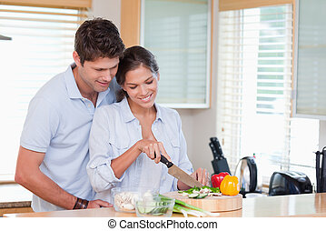 Happy couple cooking