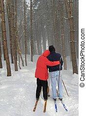 happy couple cross country skiing