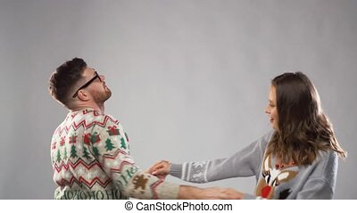 happy couple dancing at christmas party - celebration, fun...