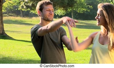 Happy couple dancing outdoors