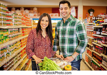 Happy couple doing some shopping