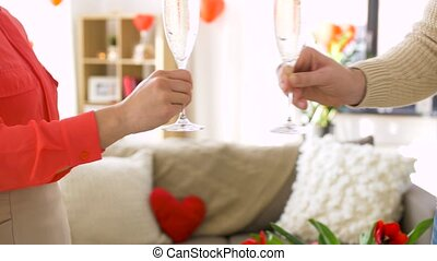 happy couple drinking champagne at valentines day -...