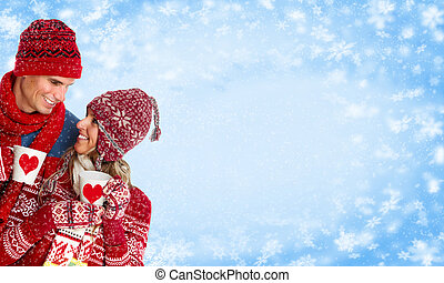 Happy couple drinking hot tea. Christmas background.