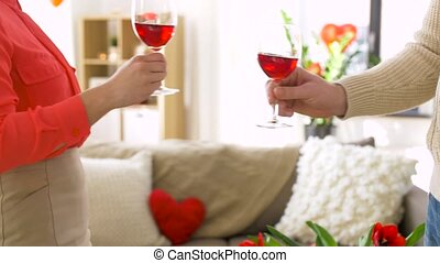 happy couple drinking red wine at valentines day
