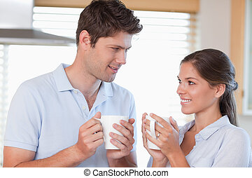 Happy couple drinking tea