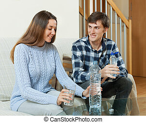 Happy couple drinking water