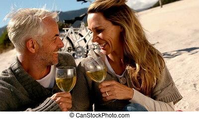 Happy couple drinking white wine on