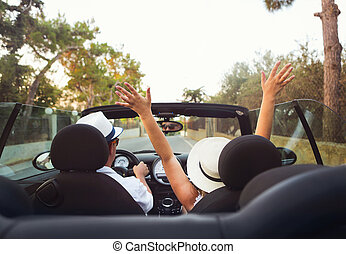 Happy Couple Driving  in Car