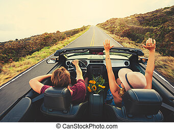 Happy Couple Driving in Convertible - Happy Young Carefree...