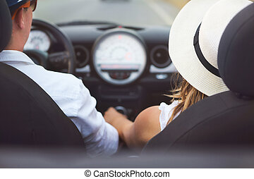 Happy Couple Driving on Country Road  in Car