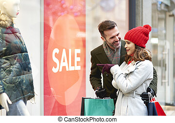 Happy couple during the window shopping