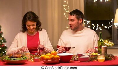 happy couple eating at christmas dinner