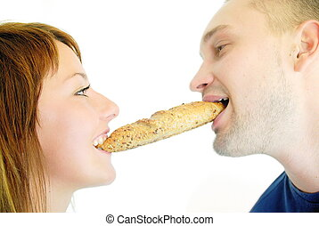 happy couple eating croissant