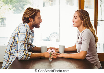Happy couple enjoying a coffee