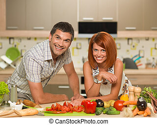 happy couple enjoying cooking