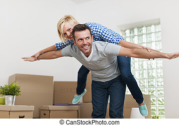 Happy couple enjoying in their new apartment