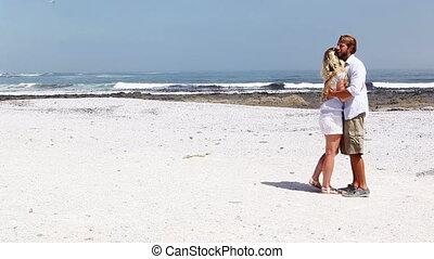 Happy couple enjoying the beach on a sunny day