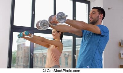 happy couple exercising at home - sport, fitness, lifestyle ...