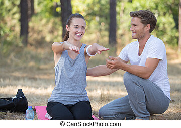 happy couple exercising outdoors