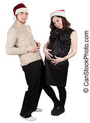 Happy Couple Expecting Baby. Beautiful Young Pregnant Woman and Her Husband Sitting Together