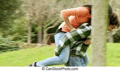 Happy couple fighting in park - Boyfriend and girlfriend...