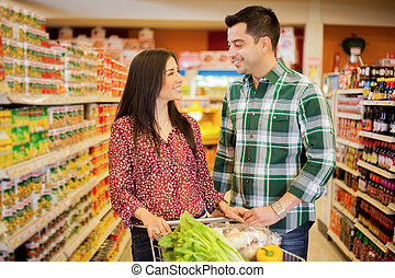 Happy couple flirting at the store