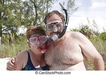happy couple going snorkeling