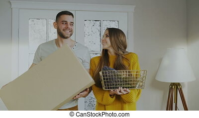 Happy couple happy to enter their new home at first time -...
