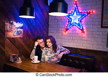 Happy couple have fun in cafe