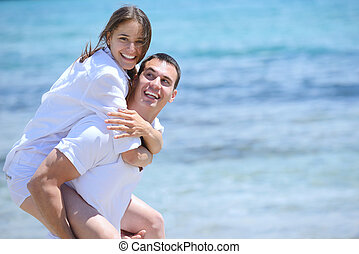 happy couple have fun on the beach - happy young couple have...