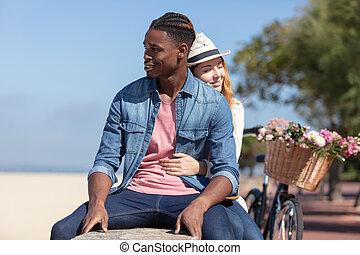 happy couple having a good time at the beach