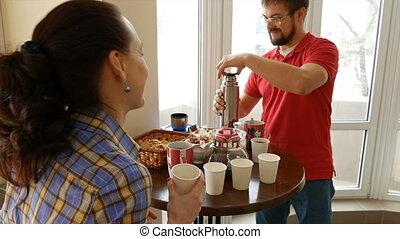 Happy couple having a snack break drinking tea - Happy...