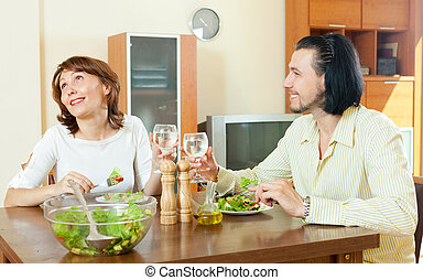 couple having dinner at the house of green vegetables