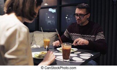 happy couple having dinner at vegan restaurant - eating,...